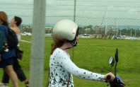 Scooter Safety:Can you tell what is wrong in this photo?She is wearing her helmet